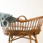 gray textile hanging on brown wicker basket