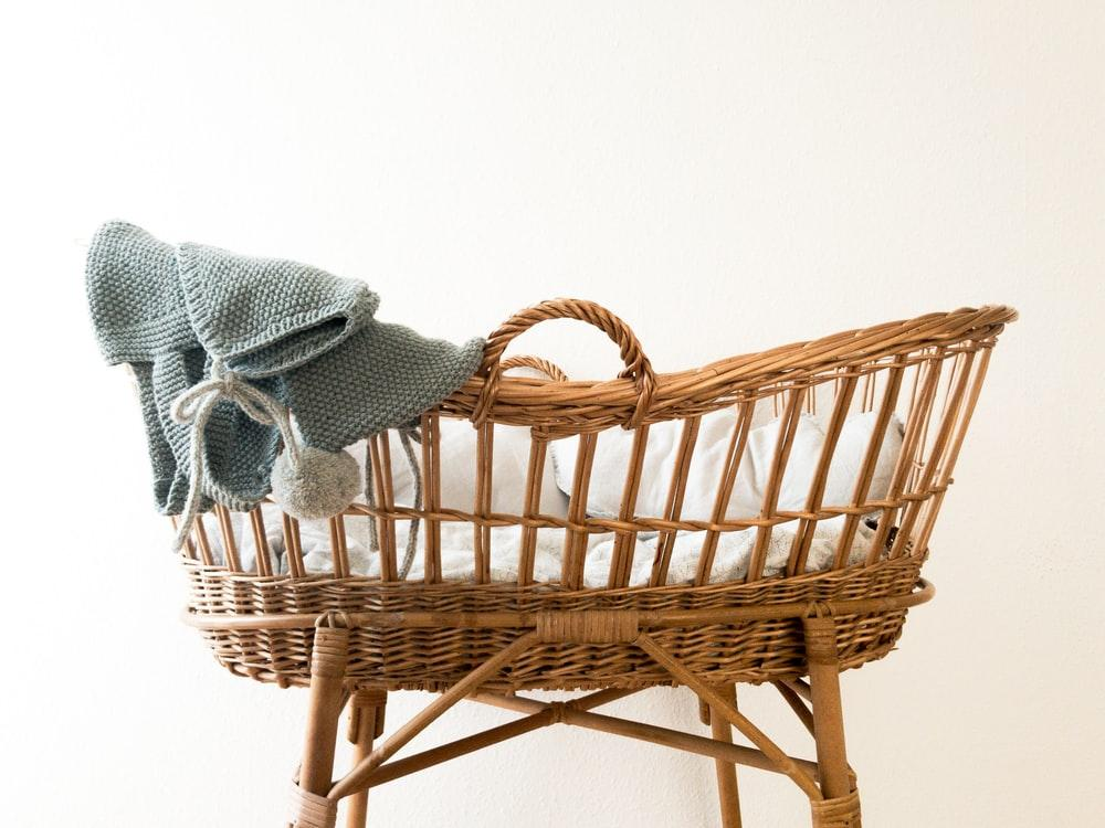 gray textile hanging on brown wicker basket