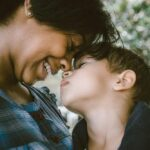 selective focus photography of woman and boy